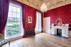 The Queen Adelaide Room, with its lavish deep red, patterned wall-paper
