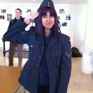 Young person trying on RAF Uniform - part of the Museum's handling collection.